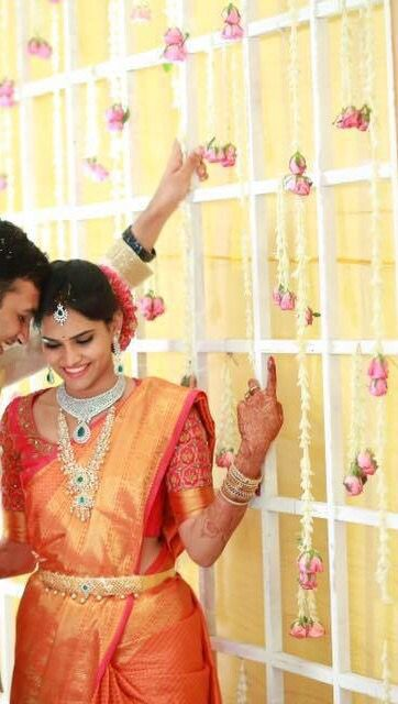 South Indian bride. Diamond Indian bridal  jewelry. Jhumkis.Orange kanchipuram sari.Braid with fresh jasmine flowers. Tamil bride. Telugu bride. Kannada bride. Hindu bride. Malayalee bride.Kerala bride.South Indian wedding