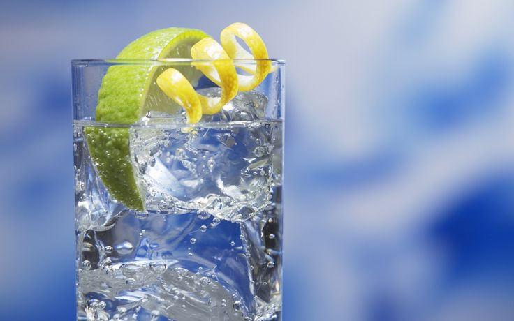 Gin and tonic: 1 part gin, 2 parts tonic. Garnish with lemon or lime. The background and garnish are the only things with colour, but they add the dimension to the actual drink