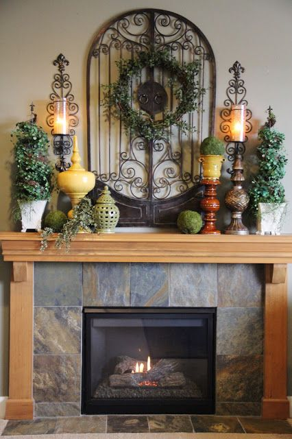 Reminds me of our fireplace minus the wood. Cute decorations LOVE the earth tones and metal for Summer Mantle Decoration Inspiration