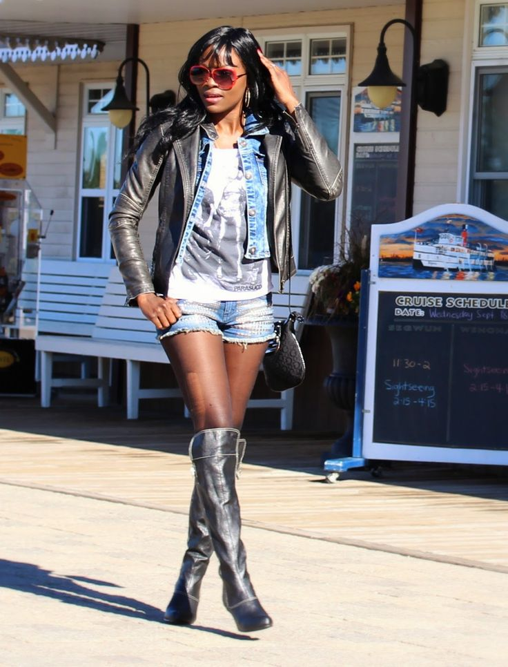 lil mama wearing leather boots, jacket, jean jacket and a black bag