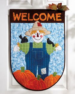 Whimsical Welcome from Quilting Celebrations Fall 2013 is a wallhanger that features an appliquéd scarecrow and pumpkins.