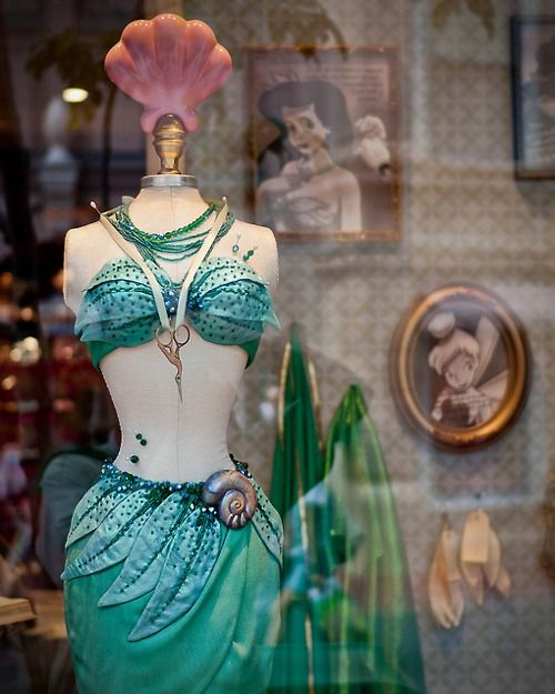 Beautiful mermaid costume. Of course this has to be in a store front window at Disney. It's far too perfect ;)