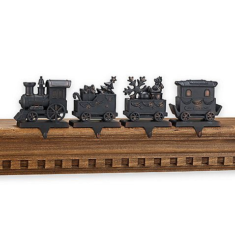 weighted stocking hangers .... creates an entire train across your mantle. Bed bath and beyond.