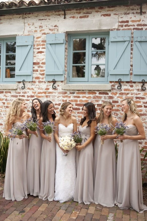 Love the nude bridesmaid dresses with the brick building and shutters behind it. wedding-stuff