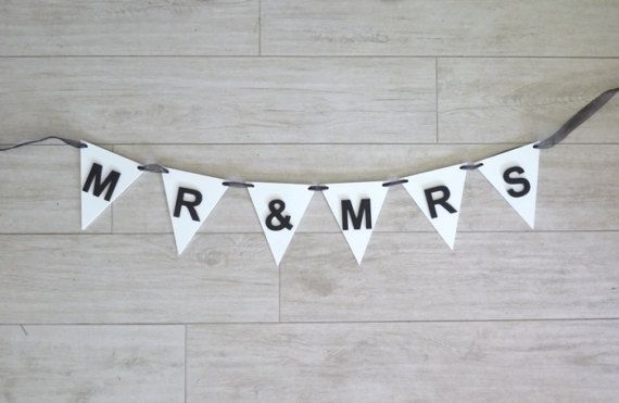 These beautiful Mr and Mrs Bunting Wedding Signs will add a special touch to your special day. Use them as a centrepiece in front of the bridal table. Mr and Mrs bunting signs can also be used for back drops and photo props for your special day. With over 25 colours to choose from you will be sure to find the right combination that works for you.  Each bunting flag and letter is made of 3mm MDF. Flags measure 13cm wide x 15cm long. Letters are 5.5cm high. Organza ribbon is then woven through…