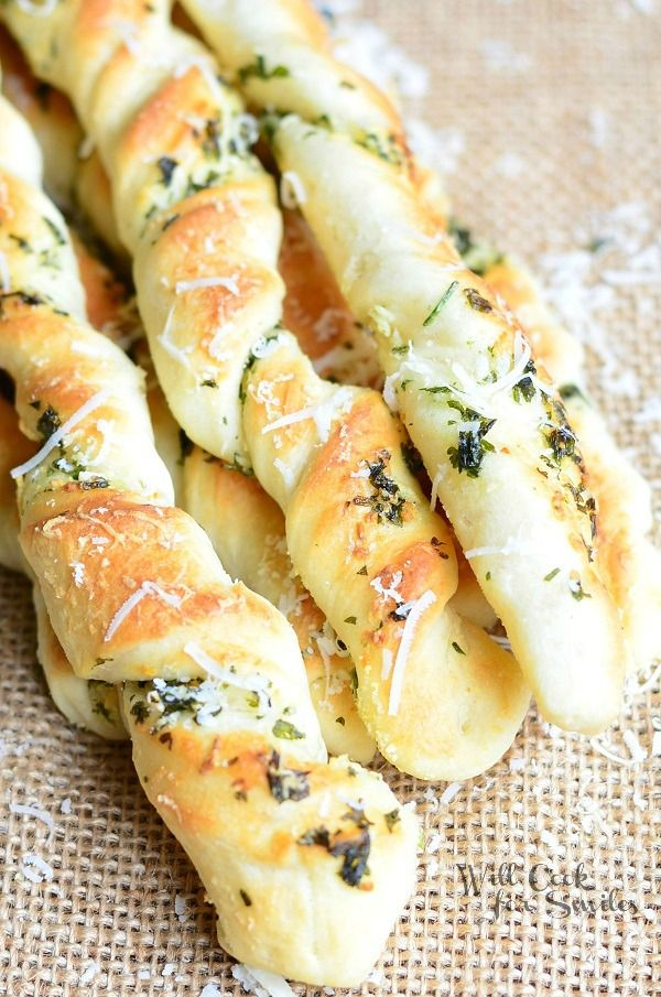 Scrumptious homemade breadsticks flavored with fresh herbs, fresh Parmesan cheese and garlic. Perfect side for any gathering!