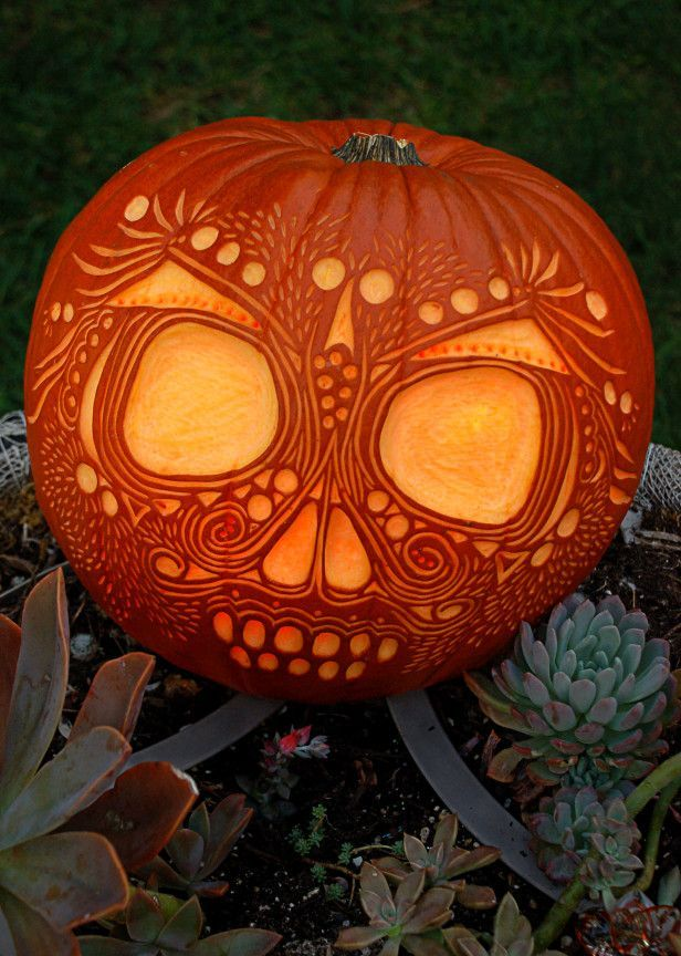 Dia de los Muertos Skull - This decorative pumpkin skull captures the festive spirit of Dia de los Muertos in memory of the dead. - At its origin, this is the same day as America's Halloween, but commercialism (which has its origins in Protestant capitalism) has eliminated - or altered perhaps - the spiritual essence of the holiday.