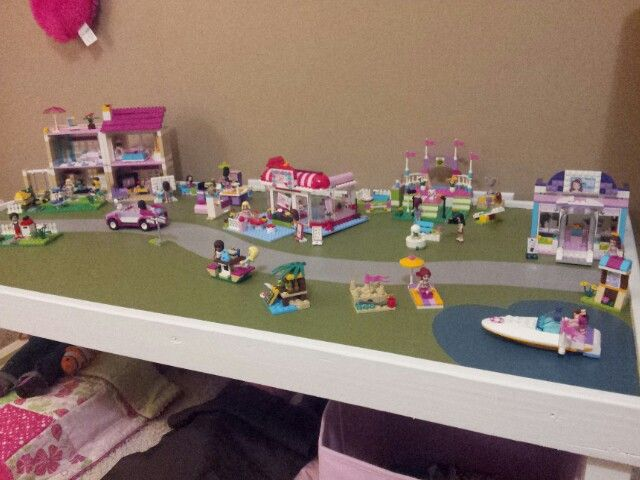 Our homemade table for our daughter's Lego Friends! Complete with a heart-shaped lake for Heartlake City!
