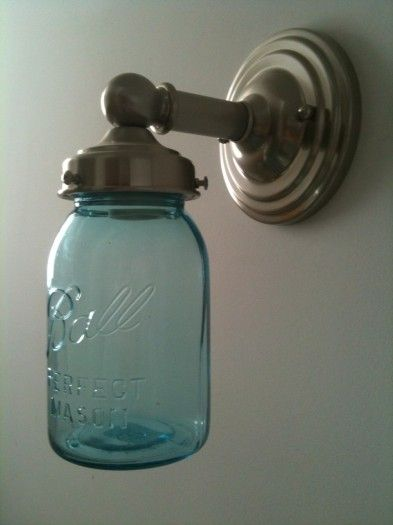 This idea uses a regular wall sconce and substitutes a blue ball jar for the shade....very clever and would look so good in my bathroom!