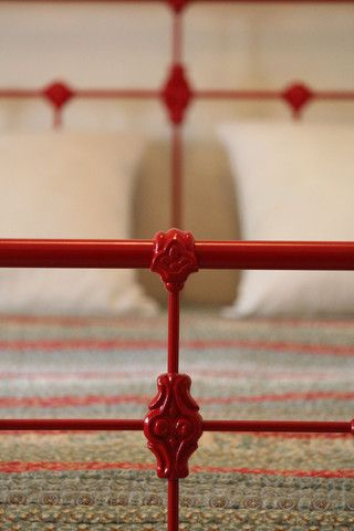 Paint my wrought iron bed red....  I'm not going to regret that decision at all!  Perfect!