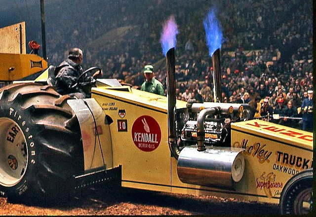 """Lloyd Mcvey driving """"super banana"""" modified tractor in the 1970's.  426 hemi with twin turbo chargers."""
