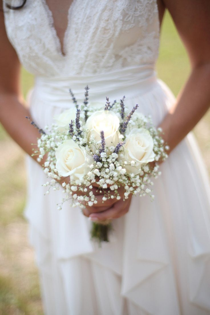 white roses, baby's breath, and purple... something?  Would prefer not lavender - check russian sage?