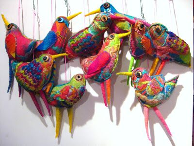 Love her use of color and sense of whimsey! These are felt.