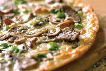 Angus Steak & Roasted Garlic Pizza From Papa Murphy's.