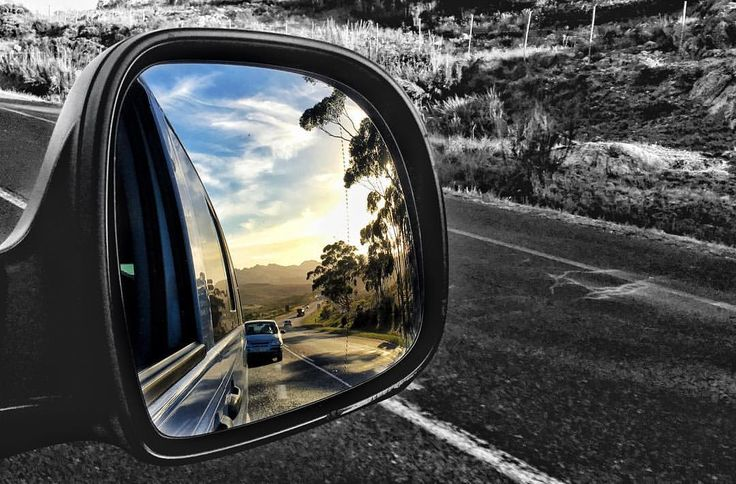 Instagram photo by @manablazemick • side mirror shot · rear view · looking back · mountains · road trip · travel · black and white · South Africa · sunset · rural · photography · traffic · transport · landscapes