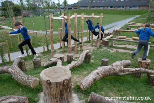 Highweek Primary School, Newton Abbot.  We created a rich play environment of rounds, tunnels, towers, huts and balance/climbing structures,  willow dens, trees, bushes and flowers and sheltered seating areas.