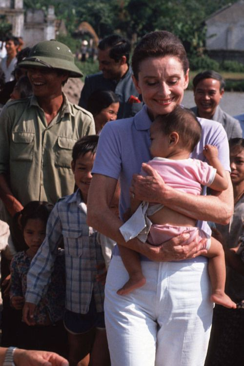 Audrey Hepburn, UNICEF's Goodwill Ambassador photographed by Peter Charlesworth while holding a small Vietnamese baby to her chest as she takes a walk about while visiting a small village close to Hanoi, Vietnam Jan 17, 1990