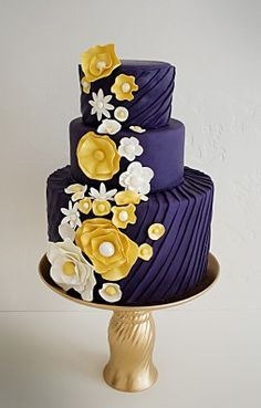 Dark Royal Blue Wedding Cake With Green Birds And Small White Yellow Flowers