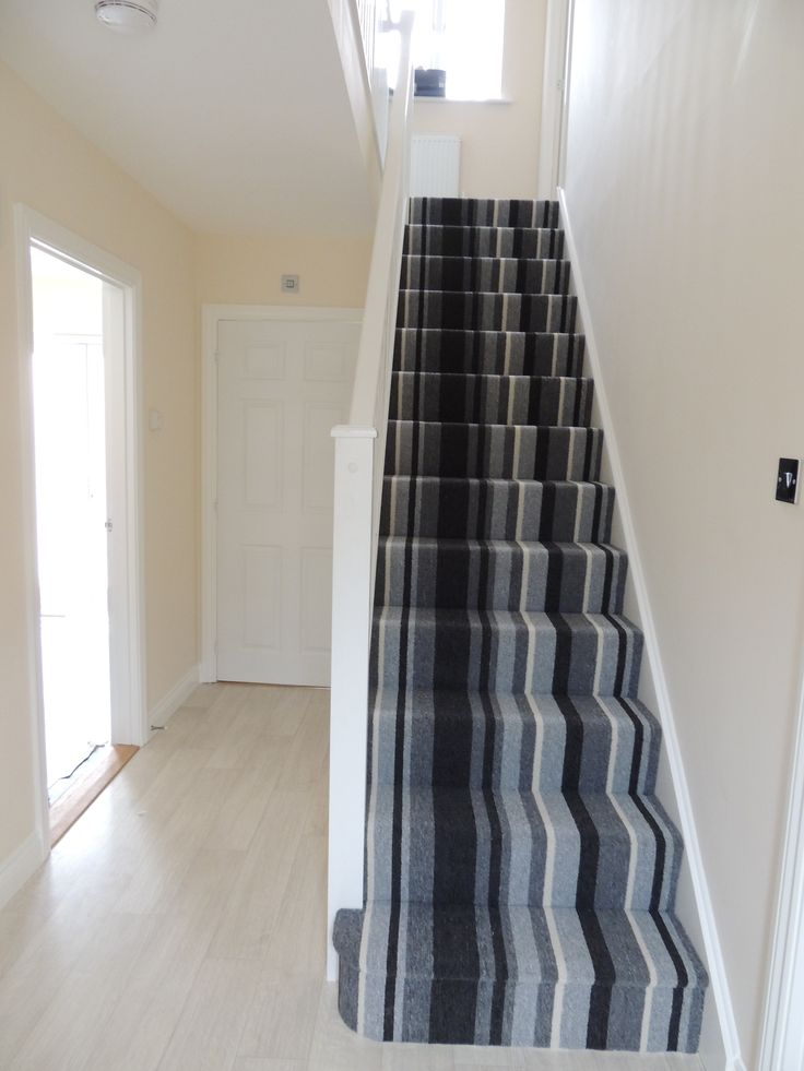 My house. Grey striped carpeted stairs.