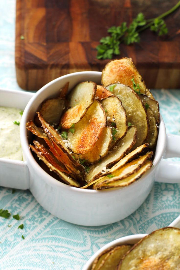 Oven Baked Potato Chips are crisp and satisfying without the frying. They can be served as an appetizer, snack, or side dish! #sidedish #potatoes