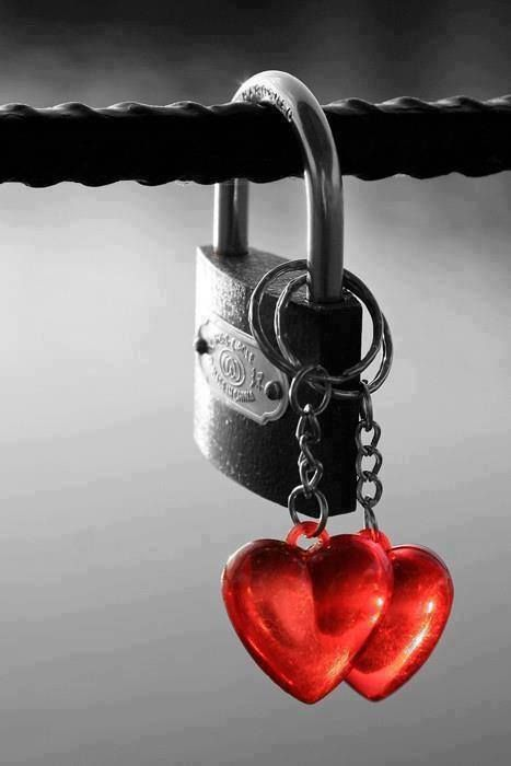 Black and white lock, red heart dangles