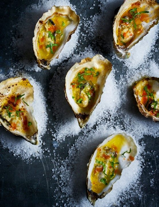 Grilled Oysters with garlic butter  These on-trend oysters are a great starter for any dinner party. They are rich with flavours of garlic and butter. Plus, they look impressive too