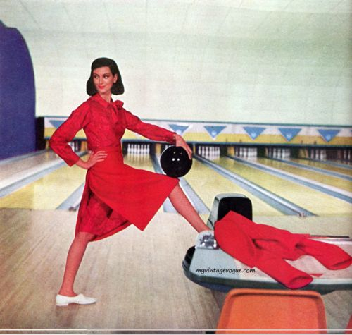 Vintage fashion layout in bowling alley. Woman in red dress. 1950s - 60s.
