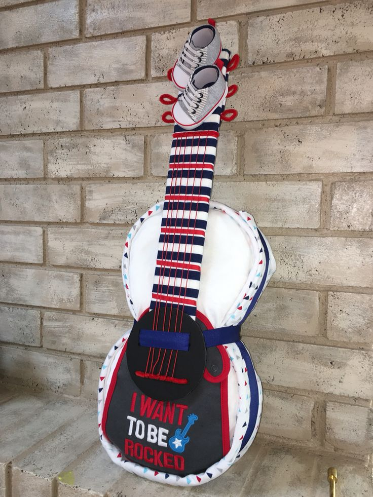 Diaper Guitar I made for my husbands diaper party. I got the instructions from https://m.youtube.com/watch?v=yvXFWdo8yAc  But I changed it up a bit.