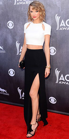 Not even a country awards show can escape the crop top trend. Taylor Swift is smokin' hot in an abs-revealing shrunken white cutout tee, a high-waist maxi with a major slit, plus chic strappy sandals. http://www.people.com/people/package/gallery/0,,20267558_20803849_30131108,00.html