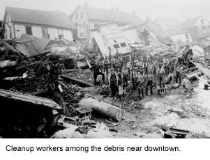 Cleanup workers among the debris near downtown Johnstown.