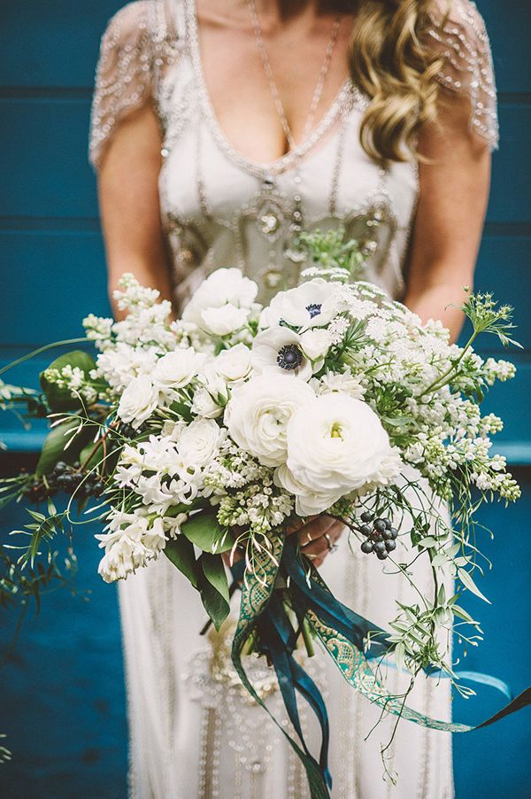 Black-eyed white anemones, white peonies, rich greenery, delicate textural flowers, and berry accents by McKenzie Powell | Seattle Wedding with Vintage Glam Flair via @ruffled