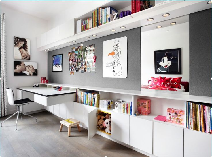 A contemporary girl's room with a long, built-in cabinet, shelves and floating desk. Image: Amantea Architects