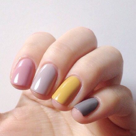 Pastel pink, yellow and grey painted nails