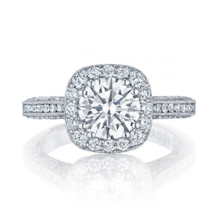 2 carat round diamond in a square Halo setting with a diamond band in white gold