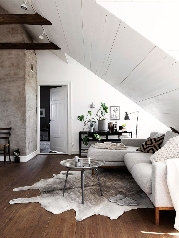 Attic living space with exposed beams in the home of Daniella Witte