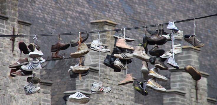 Gent, Belgium - shoes hanging - 2014