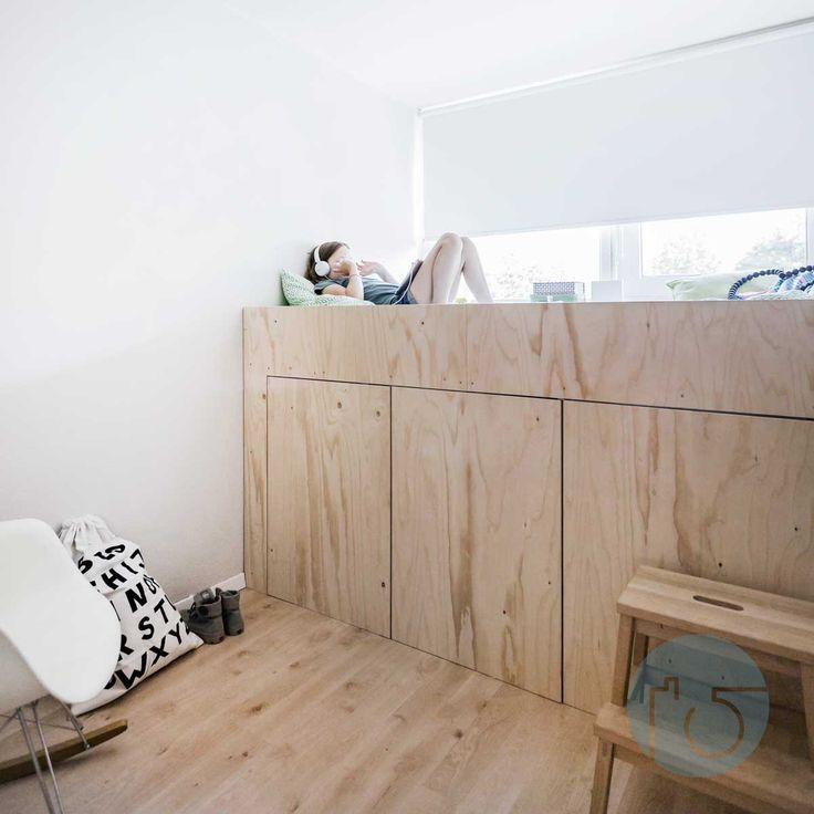 My daughter moved in to the tiniest room of the house. She made the choice herself because al she needed was her ereader, iPad and ancient Macbook. I couldn't find a bed to fit in the room so I designed this platform bed. 3 kitchen cabinets from Ikea form the base. One of them is on wheels to get acces to the storage space in the back. Instead We used plywood for the bed and the doors.  The bed is at the same height as the windowsill so she sees the trees when she wakes up!