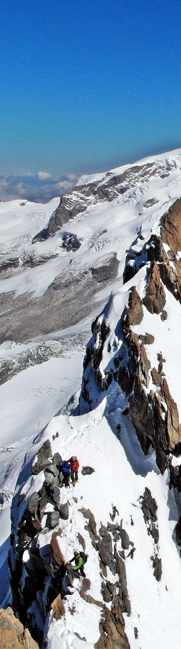 Summit ridge traverse on Breithorn massif, on the Swiss / Italian border.