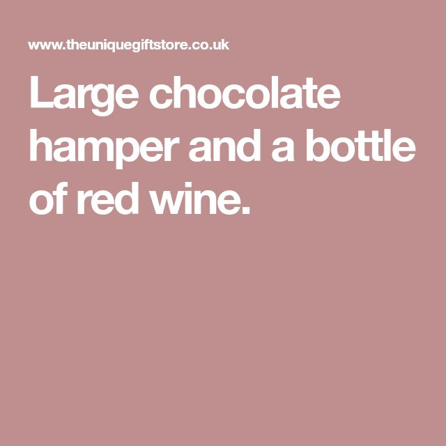 Large chocolate hamper and a bottle of red wine.