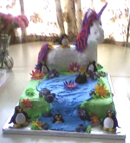 unicorn and playful penguins ~ this cake was created by my daughter for her daughter's birthday