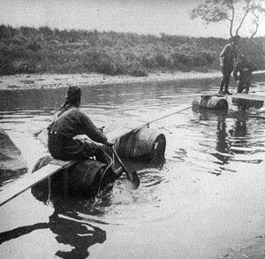 Scottish soldiers being taught how to build a pontoon.