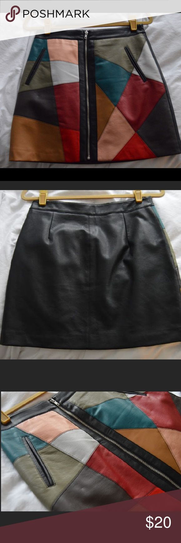 BCBGeneration Geometric Faux Leather Skirt NEVER WORN-- Super cute mini skirt from BCBGeneration. Skirt has geometric leather print, with zipper detail in the front. BCBGeneration Skirts Mini