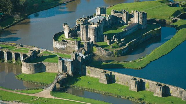 Wales has more castles than any other European county with over 600. An aerial view of Caerphilly Castle and moat in the South Wales Valleys