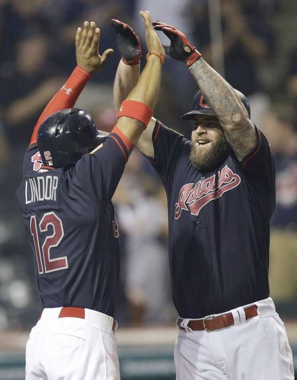 Cleveland Indians' Mike Napoli, right, is congratulated by Francisco Lindor after Napoli hit a two-run home run off Detroit Tigers' Bruce Rondon in the seventh inning of a baseball game, Tuesday, July 5, in Cleveland. Lindor scored on the play. (AP Photo/Tony Dejak)