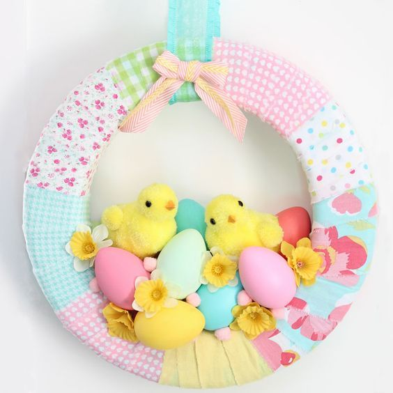 A cute Easter Chick Spring Wreath DIY decorated with Fabric, chicks, eggs, and daffodils. Spring Wreath sure to instantly bring Easter Cheer