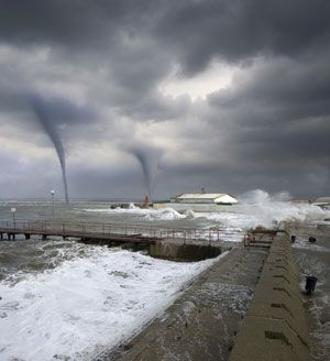 Two tornadoes form over the sea. Tornadoes can be incredibly destructive. Find out what happens when a tornado hits an urban area next. (©iStockphoto.com/Kirill Putchenko) - HowStuffWorks Storm Pictures