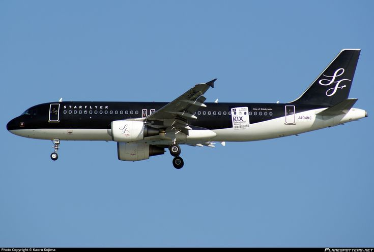 Starflyer (JP) Historic fleet Airbus A320-214 JA04MC aircraft named City of Kitakyushu, with black tale, with the sticker ''KIX & it's time to... Click'' on the airframe, on short final to Japan Tokyo Haneda Internaqtional Airport. 04/08/2009. (KIX=Champagne).(It's time to click= it's time to make a decision).(City of Kitakyushu=one designated City in Fukuoka Prefecture).