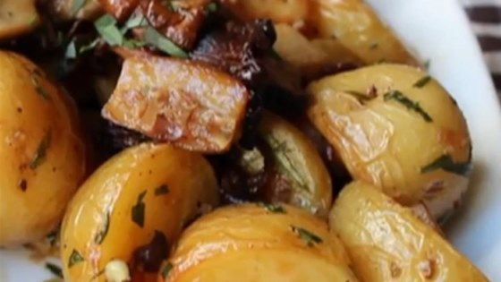 Roasted small potatoes and wild mushrooms are seasoned with fresh tarragon and garlic and drizzled with sherry vinegar for a warm salad or side dish perfect for fall.
