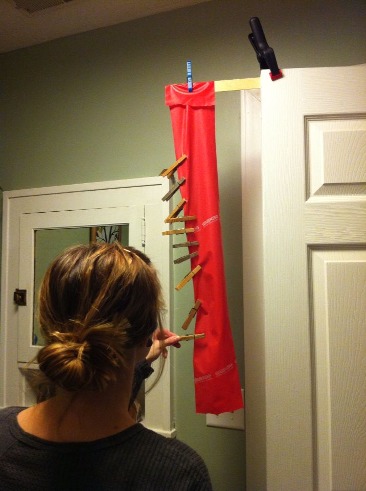 Occupational therapy home health treatment hack. Dynamic standing/standing tolerance/functional reach/fine motor/finger strength activity. 97¢ clamp, free paint stirrer, resistance band, clothes pins.