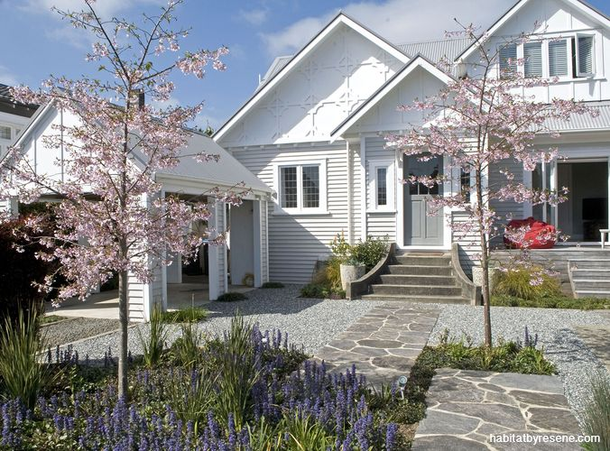 The Arts and Crafts style house is painted in a palette of soft grey-whites (Resene Seashell for the weatherboards and Resene Sea Fog for the trims) which backdrops the garden beautifully. Get the front door look with Resene Half Stack.  http://www.habitatbyresene.co.nz/nick-designs-garden-all-seasons